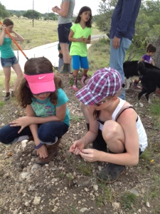 Ramsey and Sydney digging for arrowheads