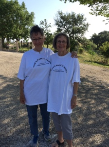 Madeline and La Nelle wearing T-shirts thatread Tom's Ranch Hands